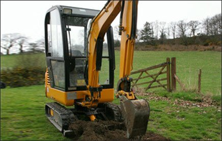 We can offer a mini digger for hire at extremely competitive rates, read more about it on our mini-diggers page.  Dont take weeks over a job that could be done in hours with a digger like this!